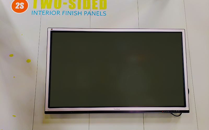 TV Mounted on Metal Wall Panels